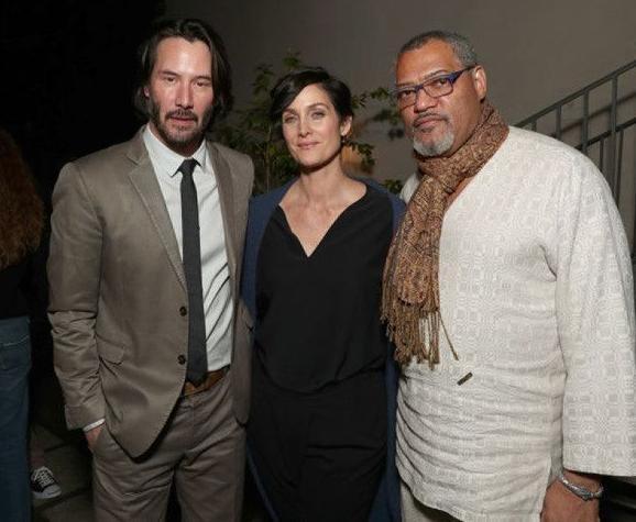 Neo, Trinity, y Morpheo, juntos 20 años después